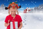picture of rudolph  - Cute little girl wearing rudolph headband against bright blue sky over clouds - JPG