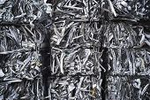 stock photo of reprocess  - Scrap aluminum bales stacked sky high - JPG