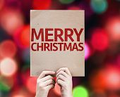 stock photo of merry chrismas  - Merry Christmas card with colorful background with defocused lights - JPG
