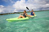 picture of west indies  - Couple canoeing in lagoon of West French indies - JPG