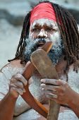stock photo of aborigines  - Portrait of one Yugambeh Aboriginal man holds boomerangs and sing during Aboriginal culture show in Queensland Australia - JPG