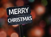 stock photo of merry chrismas  - Merry Christmas sign with colorful background with defocused lights - JPG