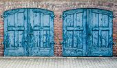 foto of lockups  - A Pair Of Heavy Old Doors On An Old Mews Or Street Of Stables Or Row Of Carriage Houses - JPG