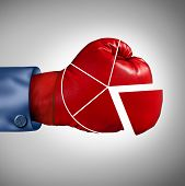 picture of competition  - Competition market share loss business concept as a red boxing glove shaped as a financial pie chart diagram as a symbol for losing economic competitiveness - JPG