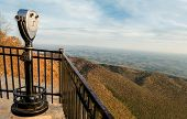 foto of appalachian  - A binocular scope on a high rocky ledge offers a spectacular view of the Appalachian Mountains on an autumn day in western South Carolina - JPG