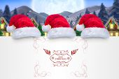 image of quaint  - Merry christmas message against quaint town with bright moon - JPG