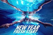 stock photo of breast-stroke  - Fit swimmer training by himself against new year fresh start - JPG