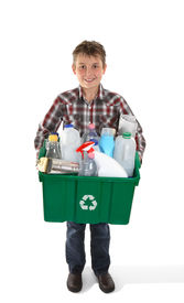 picture of recycle bin  - A child holds a recycling bin container full of tins bottles and papers suitable for recycling - JPG