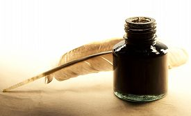 pic of inkpot  - Feather and inkpot on paper in closeup - JPG