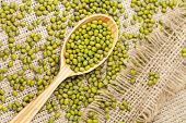 pic of mung beans  - Super foods clean eating dieting organic product mung beans in wooden spoon on vintage textile background - JPG