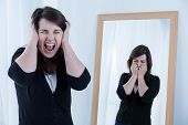 image of scream  - Screaming woman and her reflection in the mirror - JPG