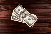 picture of american money  - Wooden table with money american hundred dollar bills - JPG