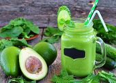 foto of smoothies  - Green vegetable smoothie on wood background - JPG
