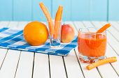 foto of light weight  - Healthy homemade carrot juice in glass and fresh carrot - JPG