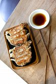 foto of soy sauce  - Japanese raviolis and soy sauce on a table - JPG