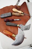 pic of leather tool  - Saddlery and Leather Tools on brown leather - JPG
