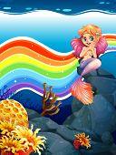 stock photo of mermaid  - Underwater scene with mermaid and rainbow - JPG