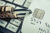 stock photo of malware  - a security lock with password with a credit card on white computer keyboard representing credit card data encryption for financial security - JPG