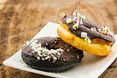 pic of sprinkling  - Chocolate donut with Sprinkles on white plate - JPG