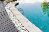 image of edging  - edge of the swimming pool decorating with white stone - JPG