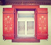 foto of chalet  - Window on the Facade of Swiss Chalet Retro Effect - JPG