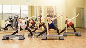 picture of step aerobics  - Group of women making step aerobics in the fitness class - JPG