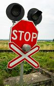 picture of railroad-sign  - Traffic lights stops sign and crossbuck sign at the railroad crossing in Ukraine - JPG