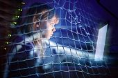 stock photo of addict  - Little girl working on laptop at night in a fishing net Internet addiction disorder conceptual photo collage - JPG