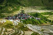 stock photo of ifugao  - Amazing panorama view of rice terraces fields and village houses in Ifugao province mountains - JPG