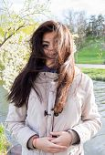 picture of windy  - Mersmerized beautiful girl in windy afternoon outdoors - JPG
