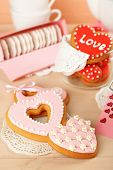 image of tea bag  - Heart shaped cookies for valentines day and tea bags on wooden background - JPG