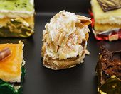 picture of petition  - Assortment of petit four pastries Sweet food and desserts - JPG
