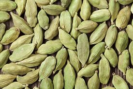 stock photo of cardamom  - Cardamom green super food indian aroma spice close up background texture - JPG