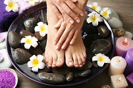 foto of pedicure  - Female feet at spa pedicure procedure - JPG