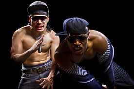 foto of gangsta  - Rap concert with two muscular shirtless men with microphones - JPG