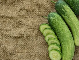 picture of cucumbers  - cucumbers and cucumber slice on sack background - JPG