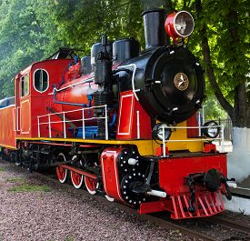 foto of steam  - Steam locomotive blowing off the steam at the station - JPG