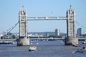 Tower Bridge And Tourist Boats poster