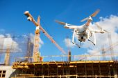 Drone over construction site. video surveillance or industrial inspection poster