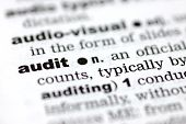 foto of pronunciation  - A close up of the word audit from a dictionary - JPG