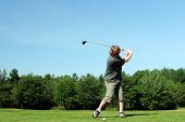 image of pro-life  - Man tees off at the golf course.