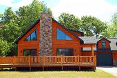 picture of log cabin  - Shot of luxurious vacation home log cabin - JPG