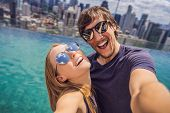 Young Happy And Attractive Playful Couple Taking Selfie Picture Together At Luxury Urban Hotel Infin poster