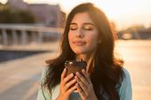 Tranquil Girl Enjoying Takeaway Coffee, Walking In City At Sunset poster