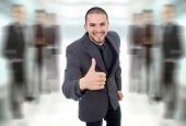 pic of feeling stupid  - young business man going thumb up - JPG
