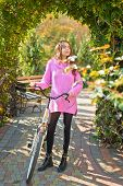 Motion Is Happiness. Woman With Bicycle In Blooming Garden. Weekend Activity. Active Leisure And Lif poster