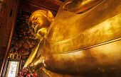 Statue Of Lying Reclining Buddha In Wat Pho (pho Temple) Bangkok Thailand, Represents The Entry Of B poster
