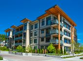 Brand New Apartment Building On Sunny Day In British Columbia, Canada poster