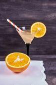 Sliced Orange Next To Martini Goblet With Fresh Orange Juice And Orange Slice, Cocktail Tube, On A D poster