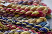 Multicolored Braided Threads For Embroidery. Colorful Braided Thread poster